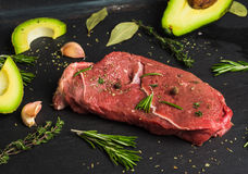 Fresh raw beef meat with avocado and herbs Royalty Free Stock Photos