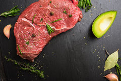 Fresh raw beef meat with avocado and herbs Royalty Free Stock Images