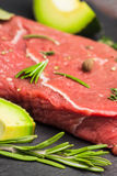 Fresh raw beef meat with avocado and herbs Stock Images