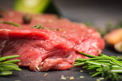 Fresh raw beef meat with avocado and herbs Stock Photos