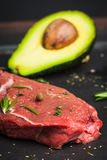 Fresh raw beef meat with avocado and herbs Stock Photo