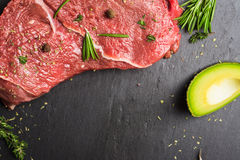 Fresh raw beef meat with avocado and herbs Royalty Free Stock Photography