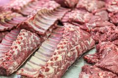 Fresh and raw beef meat chops in a market or shop.  Stock Photo