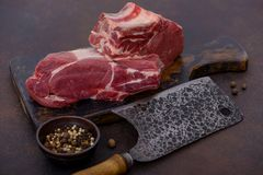 Fresh and raw beef meat on cutting board. With knife and spices Royalty Free Stock Photography