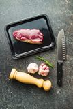 Fresh raw beef meat. Fresh raw beef meat in foil box on old kitchen table Stock Images
