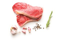 Fresh raw beef meat. Fresh raw beef meat, garlic, pepper and rosemary isolated on white background Stock Photos