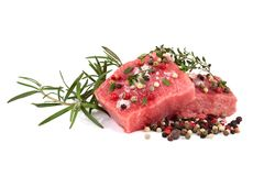 Fresh raw beef meat. Slices with color peppercorn and rosemary  over white background Royalty Free Stock Images
