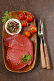 Fresh raw beef meat with pepper and herbs Royalty Free Stock Photos