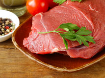 Fresh raw beef meat with pepper and herbs Stock Photo