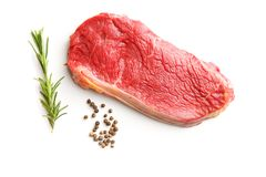 Fresh raw beef meat. Fresh raw beef meat with pepper and rosemary Royalty Free Stock Image