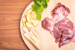 Fresh raw beef meat slices on wooden. Ready to cooking on wood table Stock Photos