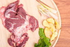Fresh raw beef meat slices on wooden. Ready to cooking on wood table Royalty Free Stock Photos