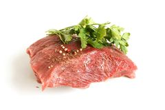 Fresh raw beef meat with spices. On a white background Stock Images