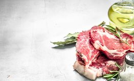 Fresh raw beef meat with spices and herbs. On rustic background Royalty Free Stock Image