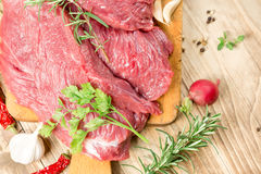 Fresh raw beef meat with spices, seasoning ready for baking - roasting. Raw, fresh beef meat with spices, seasoning ready for baking - roasting Royalty Free Stock Photo