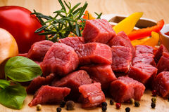 Fresh raw beef. Fresh raw meat and vegetables Royalty Free Stock Photos