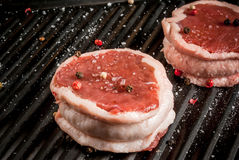 Fresh raw beef medallions. In a frying pan for grilling. Close view, copy space Stock Image