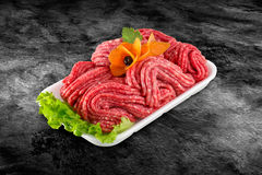 Fresh raw beef minced meat decorated with vegetables and clipping path.  Stock Photos