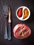 Fresh raw beef steak on black stone Stock Images