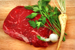 Fresh raw beef steak on cutting board. And vegetables Royalty Free Stock Photo