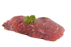 Fresh raw beef steak isolated on white. With parsley Royalty Free Stock Photo
