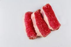 Fresh raw beef steak isolated on white. Slice beefsteak Royalty Free Stock Photo
