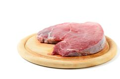 Fresh raw beef steak isolated. Fresh raw beef steak on wood block isolated on white background Stock Images