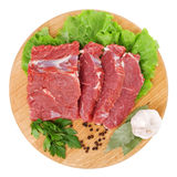 Fresh raw beef steak meat. On cutting board in closeup over white background Stock Images