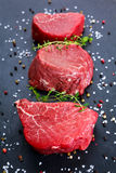 Fresh Raw Beef steak Mignon, with salt, peppercorns, thyme, garlic. Stock Photography