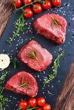 Fresh Raw Beef steak Mignon, with salt, peppercorns, thyme, garlic. Fresh Raw Beef steak Mignon, with salt, peppercorns, thyme, garlic Ready to cook Stock Photos