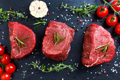 Fresh Raw Beef steak Mignon, with salt, peppercorns, thyme, garlic. Ready to cook Royalty Free Stock Photo