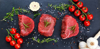 Fresh Raw Beef steak Mignon, with salt, peppercorns, thyme, garlic. Fresh Raw Beef steak Mignon, with salt, peppercorns, thyme, garlic Ready to cook Royalty Free Stock Photography
