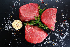 Fresh Raw Beef steak Mignon, with salt, peppercorns, thyme, garlic. Fresh Raw Beef steak Mignon, with salt, peppercorns, thyme, garlic Ready to cook Stock Image