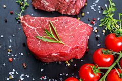 Fresh Raw Beef steak Mignon, with salt, peppercorns, thyme, garlic Ready to cook.  Stock Photography