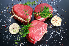 Fresh Raw Beef steak Mignon, with salt, peppercorns, thyme. Ready to cook Stock Photo
