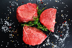 Fresh Raw Beef steak Mignon, with salt, peppercorns, thyme. Fresh Raw Beef steak Mignon, with salt, peppercorns, thyme, Ready to cook Stock Image