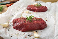 Fresh raw beef steak. On rustic wooden table Royalty Free Stock Photography