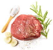 Fresh raw beef steak. And spices isolated on white background, top view Stock Image