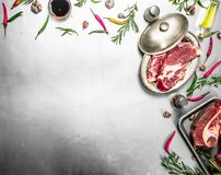Fresh raw beef steak with spices. On rustic background Royalty Free Stock Photography