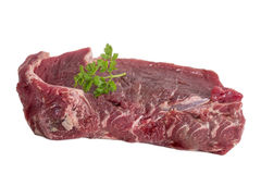 Fresh raw beef steak on white. With parsley Royalty Free Stock Photography
