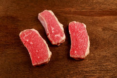 Fresh raw beef steak  on white. Slice beefsteak Royalty Free Stock Images