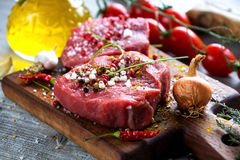 Fresh raw beef steak. On wooden background Stock Photos