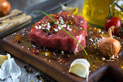 Fresh raw beef steak. On wooden background Royalty Free Stock Image