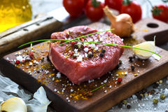 Fresh raw beef steak. On wooden background Royalty Free Stock Photo