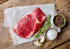 Fresh raw beef steak. On wooden table, top view Stock Photography