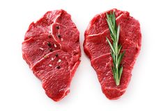 Fresh raw beef steaks, pepper and rosemary isolated on white background. With clipping path Stock Photography