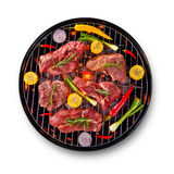 Fresh raw beef steaks placed on grill, isolated on white backgro. Fresh raw beef steaks with vegetable placed on grill, isolated on white background. Cooking Stock Image