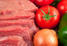 Fresh raw beef with vegetables closeup. Top view Royalty Free Stock Image