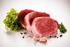 Fresh raw beef on white background. Fresh raw beef with vegetables on white background Royalty Free Stock Photos