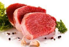 Fresh raw beef on white background. Fresh raw beef with vegetables on white background Royalty Free Stock Images